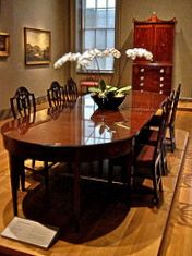 Dining Room Tables - The Most Important Piece in the Dining Room: A traditional mahogany dining room table with a french polish.