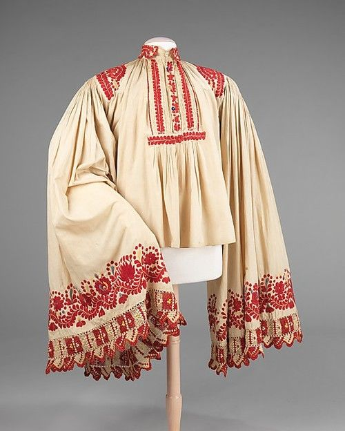 Shirt. Late 19th century, Hungary. The dramatic form of this shirt provides a large canvas for embroidery. Its sleeves are exaggerated both in length and fullness and likely originated in ancient ecclesiastical garments, such as the alb.  Source: Met Museum