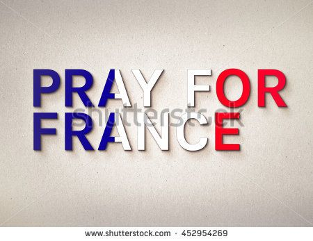 Pray for France word with France Flag on background. Concept for hope and helpful to Nice city in France after terrorist attack in Nice, France.