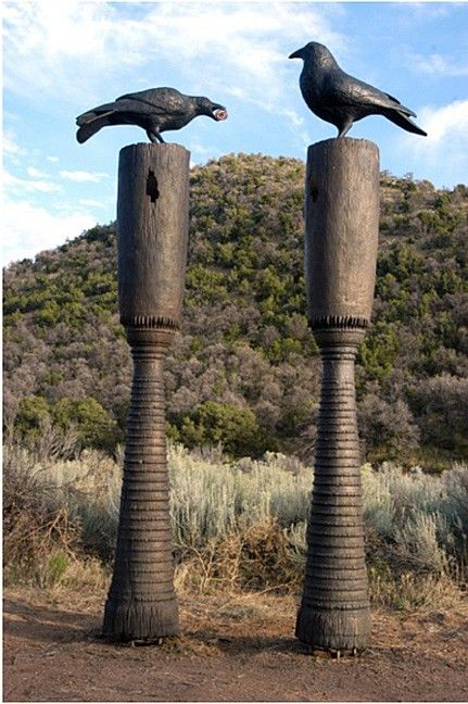 Peter Woytuk's 'Great Raven Drum'  - A pair of bronze sculptures  (2005);  12.5 feet tall x 16 inches wide