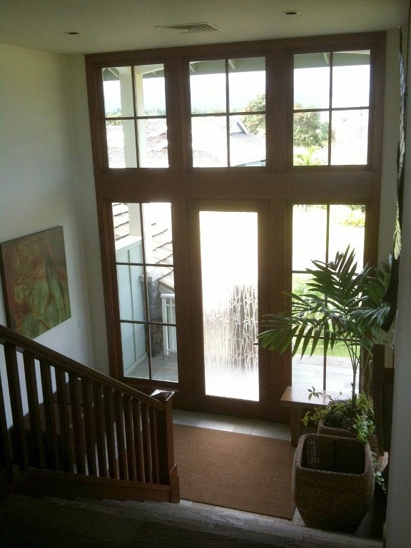 Two-story high glass entry (reno ideas for split entry home) pics from a house in Hawaii but its a good looking idea