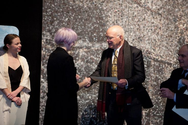 Richard Nelson presents award to Cobi Taylor
