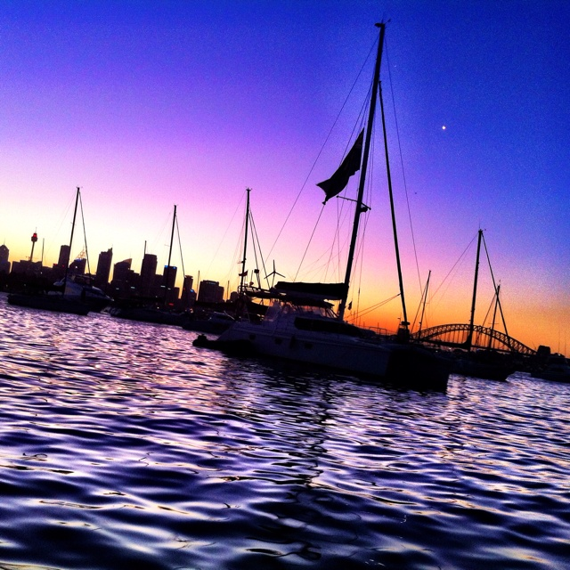Sydney harbour on a boat at sunset