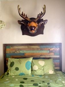 Erin's bed and DIH (did it herself) handmade headboard! AH-MAZING!