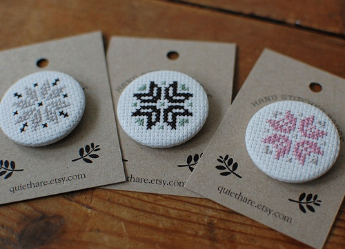 cross-stitched badges