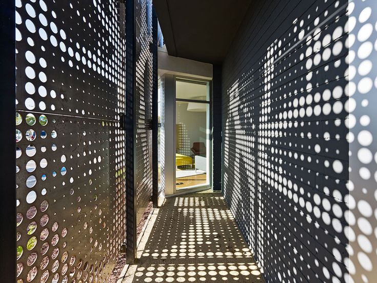 one workplace headquarters by design blitz Perforated panel metal facade different sized openings shadow in hall