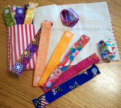 """""""quiet bag"""" - fabric chain - strips of fabric with velcro (or snaps, etc?) on each end - they link them together to make a chain"""
