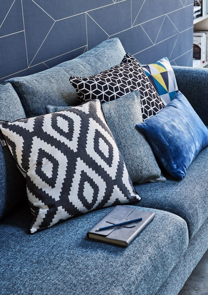 Add a modern edge to your living room with geometric cushions. Click to shop our range.