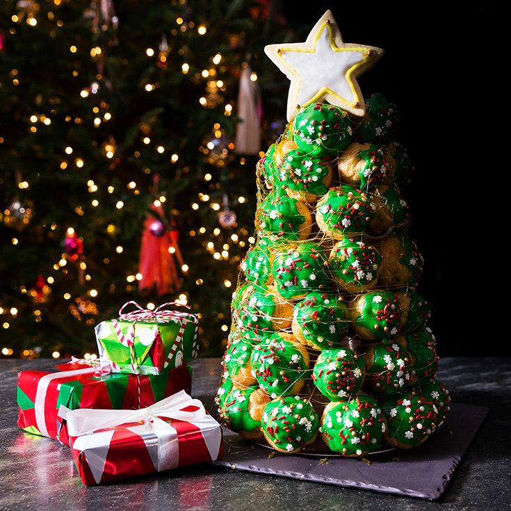 Turn the classic French croquembouche into a cream-puff Christmas tree with a green glaze, colorful sprinkles and a sugar cookie star.