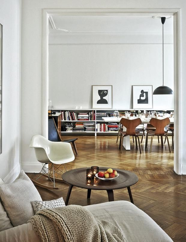 Interiors: Living room leading on to a dining room both with parquet oak flooring laid in a herringbone design