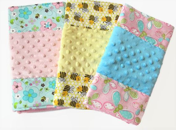 Baby girl burp cloth gift pack set of 3 packaged in a drawstring organza bag for easy giving. Bitsy Burpy premium burp cloths are designed with your babys comfort in mind. Colorful Bitsy Burpy cloths are a welcome replacement for the boring, tattered diaper draped over Mommys shoulder!! These special burp cloths are great shower gifts. Every new mother needs them.  The front consists of 3 panels. The 2 side panels are 100% cotton designer fabric. (The bee design burp cloth has flannel on the…