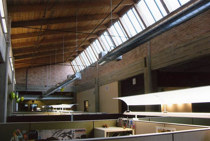 Interior of an industrial building with exposed wood for Clerestory roof design