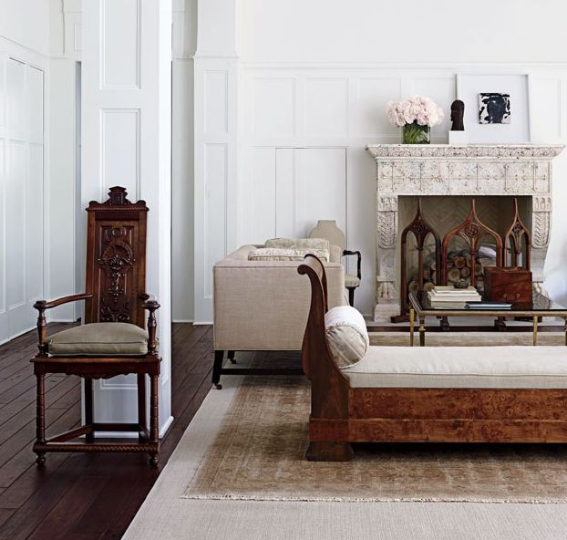 Tudor Revival house by Donald Lococo and Darryl Carter . Carter conceived the sofas, the cocktail table is attributed to Jansen, and a Renaissance Revival armchair stands alongside an antique French daybed; the paneling is painted in a white from Carter's line for Benjamin Moore.