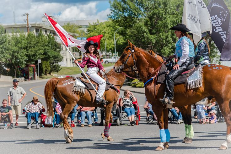 Amy Mitchell True North Strong and Free - Stampede Parade  A big part of stampede weekend is the parade through downtown Williams Lake on Saturday morning. I thought this girl looked so sweet on her horse with a great big Canadian flag waving in the wind. What a great parade, it was a beautiful morning!