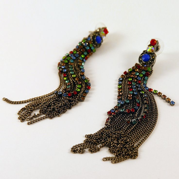 Whim: These fantastic earrings were made for party season. They are heavily embellished with multi-coloured rhinestones and are guaranteed to make you sparkle this Christmas. Want 'em? Find them here: http://www.eleanorhalljewellery.com/collections/christmas/products/whim