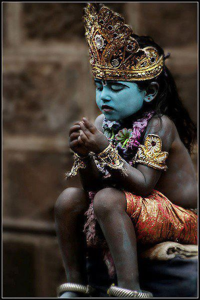 Little Shiva (on the opposite of Vishnu, only the face or the throat is painted blue ~ not the full body).