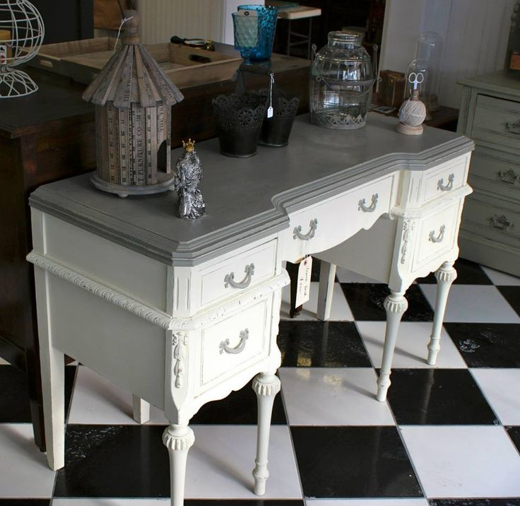 Beautiful vanity/desk finished in Chalk Paint™ decorative paint by Annie Sloan in Old White and French Linen with clear wax and light distressing. By The Painted Bench