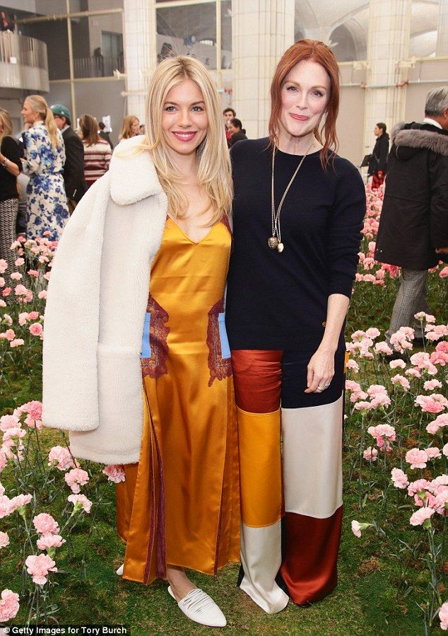 e17674d4300e Sienna Miller and Julianne Moore attend the Tory Burch runway show at New  York .