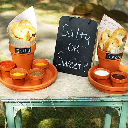 """Pretzel Station Idea: create a """"Sweet"""" station and a """"Salty"""" station with several toppings. For the sweet station,use cinnamon, sugar and melted chocolate for the toppings. —salt and chocolate go together surprisingly well! For the salty pretzels, offer melted cheese, two types of mustard and marinara sauce."""