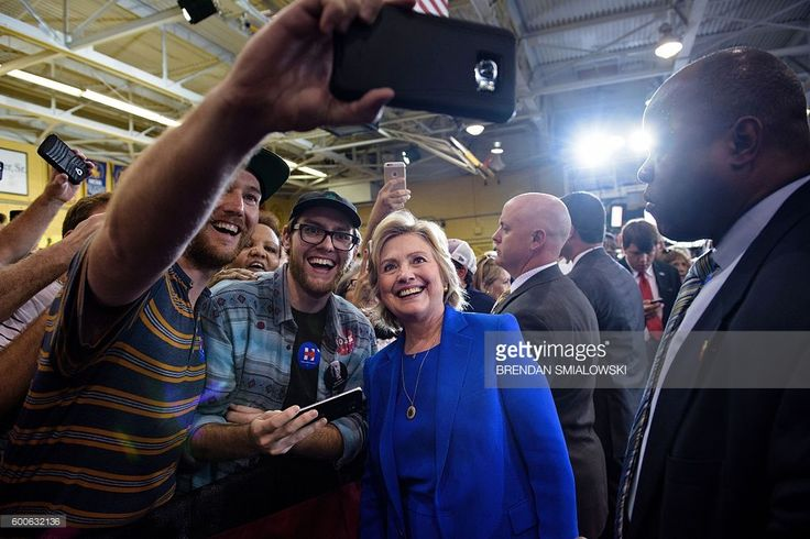 US Democratic presidential nominee Hillary Clinton poses for a selfie after a voter registration rally at Johnson C. Smith University September 8, 2016 in Charlotte, North Carolina. / AFP / Brendan Smialowski