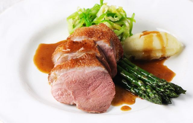Roast duck breast with asparagus, caramelised shallot and hispi cabbage recipe on Great British Chefs
