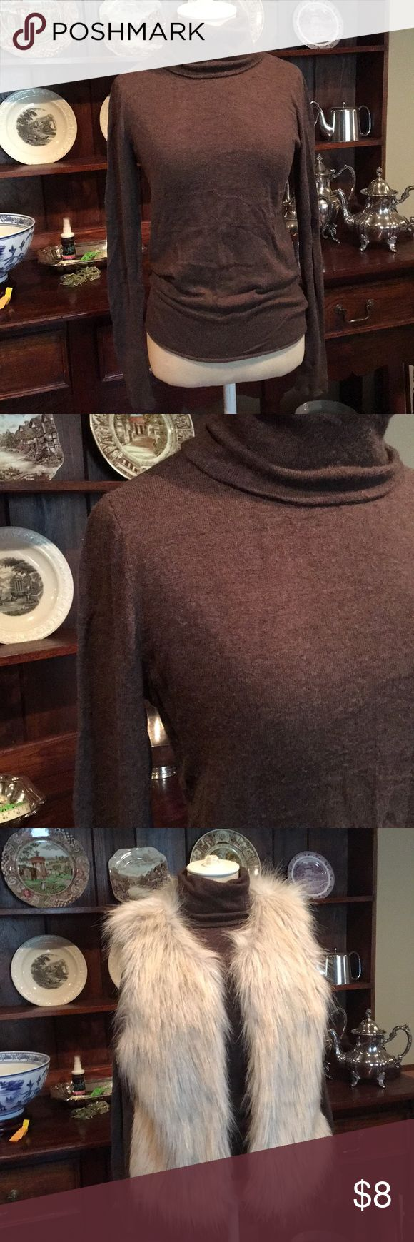 Mossimo Long Sleeve Turtle Neck Brown long sleeve turtle neck light sweater from Mossimo. This pairs perfectly with our Sanctuary Faux Fur Vest!!! 😉 Mossimo Supply Co. Sweaters Cowl & Turtlenecks
