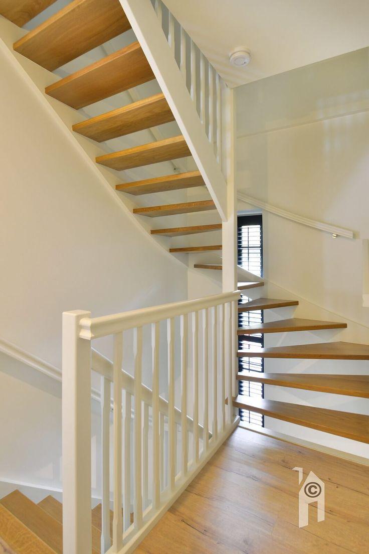 En een doorlopende, houten trap als centraal sieraad