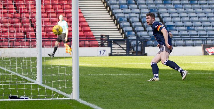 Queen's Park's Ryan McGeever scores during the Ladbrokes League One game between Queen's Park and Peterhead.