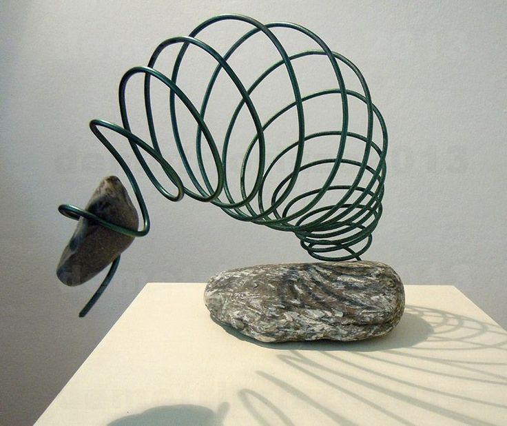 Wire sculpture by Demetrio Rizzo: Il tuffo - 2013 - wire and stones - Size: 30x30x30cm