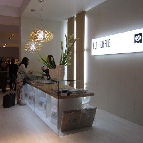 Glass and wood reception desk - Milan Furniture Fair 2011