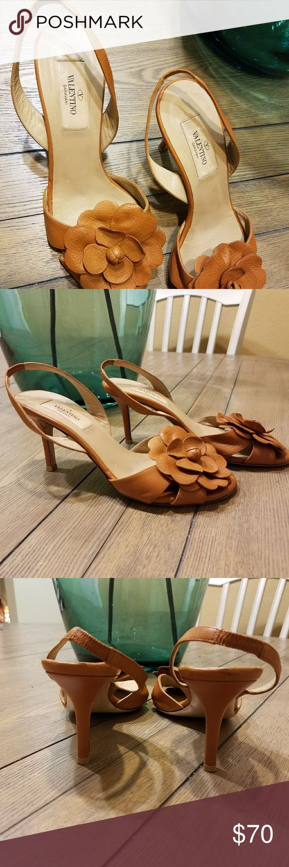 Valentino flower motif heels Beautiful Valentino flower motif heel. In very good condition. Only has two small scrapes under heel which is shown in last picture. Not visible when wearing them. Valentino Shoes