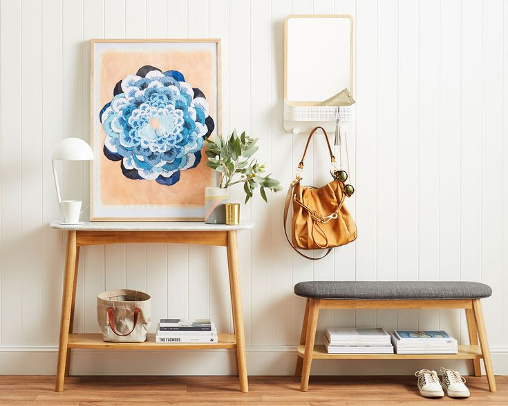 Flora: This bright and beautiful entryway is functional, feminine and fabulous. Blonde timbers, a compact console and a cute ottoman, finished off with this cool print by our new brand Lumiere Art + Co.