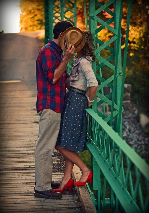 Too Cute :)    Yes, it is a sweet shot of this couple but what I like more is her outfit, polka dot skirt in blue with those red pumps!!!. i think it should be cow boy hat and boots.