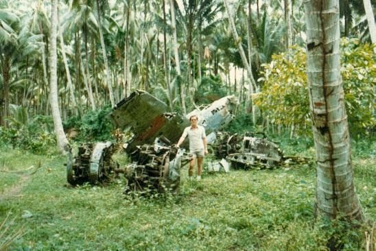An image from 1980 of a man visiting PNG war wrecks.   http://www.pagahillestate.com/exploring-world-war-ii-relics/
