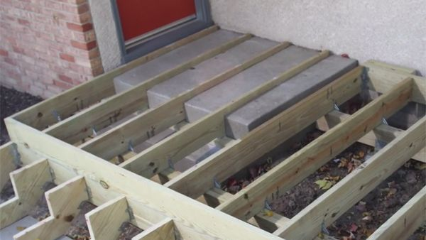 Want to build a front deck over your existing concrete steps? Here's how.