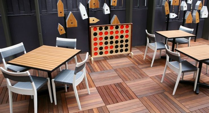 You can play Connect Four, yard Jenga set or shuffleboard on the 50-seat patio. All photos by Evy Mages.