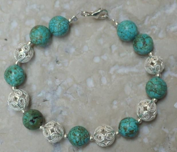 This stunning bracelet features 6 of our handmade silver filigree beads mixed with excellent quality Tibetan turquoise beads.  The turquoise beads are a mottled pale blue, and the bracelet has been threaded with sterling silver spacers between the silver & turquoise beads. The bracelet measures 18cm – please let us know if you need the length adjusted we are happy to add additional beads if necessary.  Please note the filigree beads in your bracelet my vary slightly to the ones that are…
