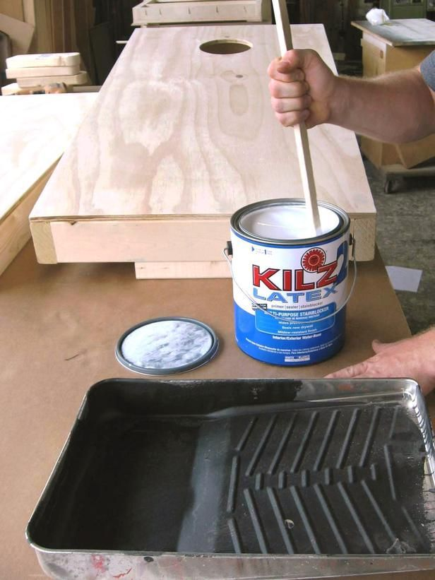 How to Build a Regulation Cornhole Set: Prime the entire box. When primer dries, re-sand the entire box. Wipe clean with light damp cloth, and paint with high-gloss paint.  From DIYnetwork.com