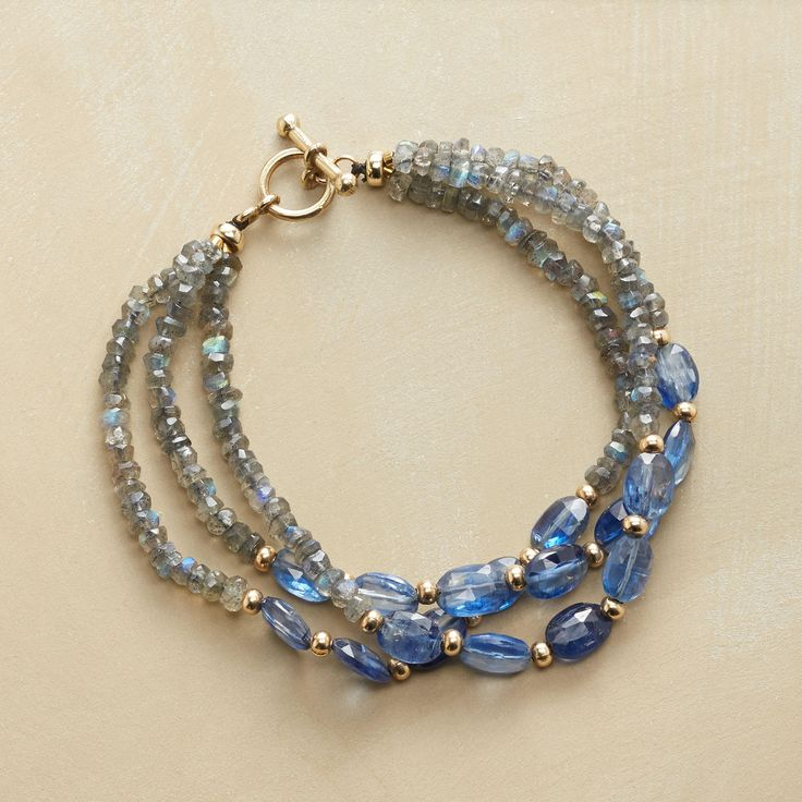 """LABRANITE BRACELET -- A swirl of stormy labradorites centered on midnight blue kyanites: three strands are sparked with 14kt gold filled beads and toggle clasp. Handcrafted Sundance exclusive. 7-1/4""""L."""