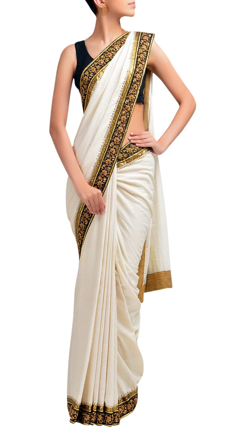 beautiful saree!: An elegant silk white/ creamish saree with black border (design foll) makes it more stylish.