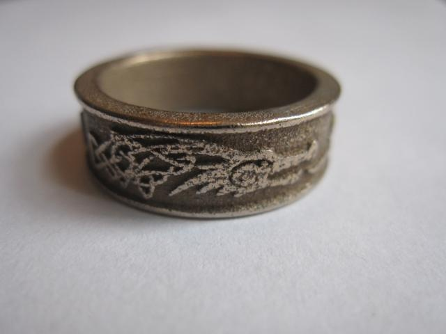 I made a ring inspired from the game Elder Scrolls V: Skyrim. I hope people who love this game also love this ring.    Your own Skyrim ring ! Write your own (character) name in Draconic language..(now it's writing Novastar)   #Skyrim #games   Available at Shapeways $20