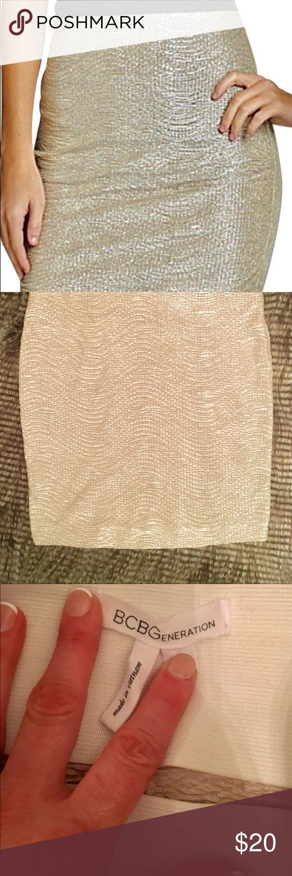 BCBG high waisted mini skirt XS Worn once. In good condition.  BCBG high waisted mini skirt in a beautiful gold metallic color with slight silver undertones.This skirt is def NOT see-through. It has a thick, but not tight, waste band around the waist makes this skirt extremely comfortable. I have never worn this (a shame, I know). It is an absolute wardrobe must-have for the holiday season! It looks amazing with black tights, ankle booties or knee high boots, and a v-neck sweater…