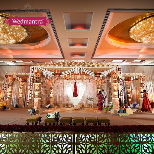 A grand stage with traditional and religious symbols. #wedmantra #weddinginindia…