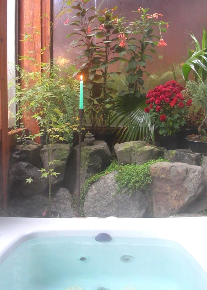 Stones, candles and flora in bathroom