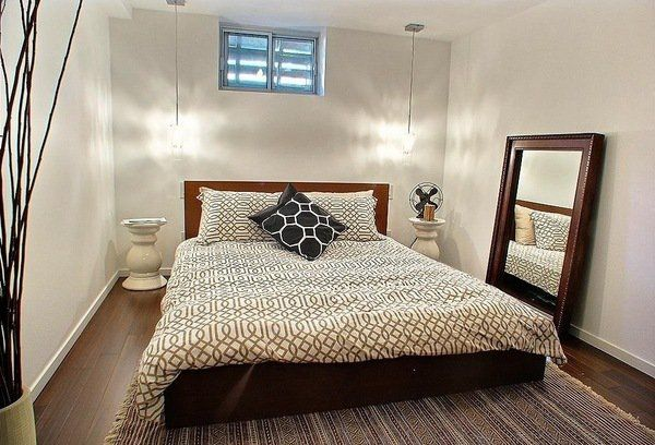 small basement bedroom ideas neutral colors framed mirror bedside tables
