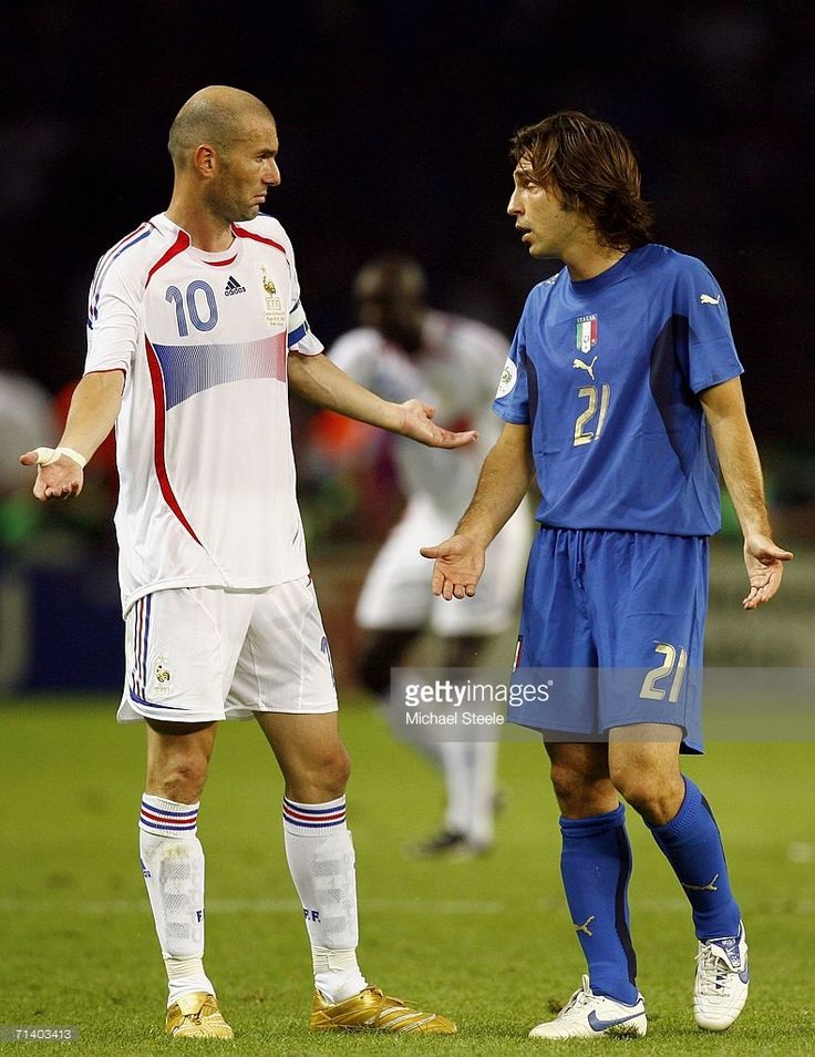 Zinedine Zidane (L) of France exchanges words with Andrea Pirlo of Italy, after headbutting Marco Materazzi of Italy in the chest during the FIFA World Cup Germany 2006 Final match between Italy and France at the Olympic Stadium on July 9, 2006 in Berlin, Germany.