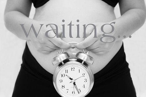 Waiting: Pregnancy photography - the clock was a great idea. Do it