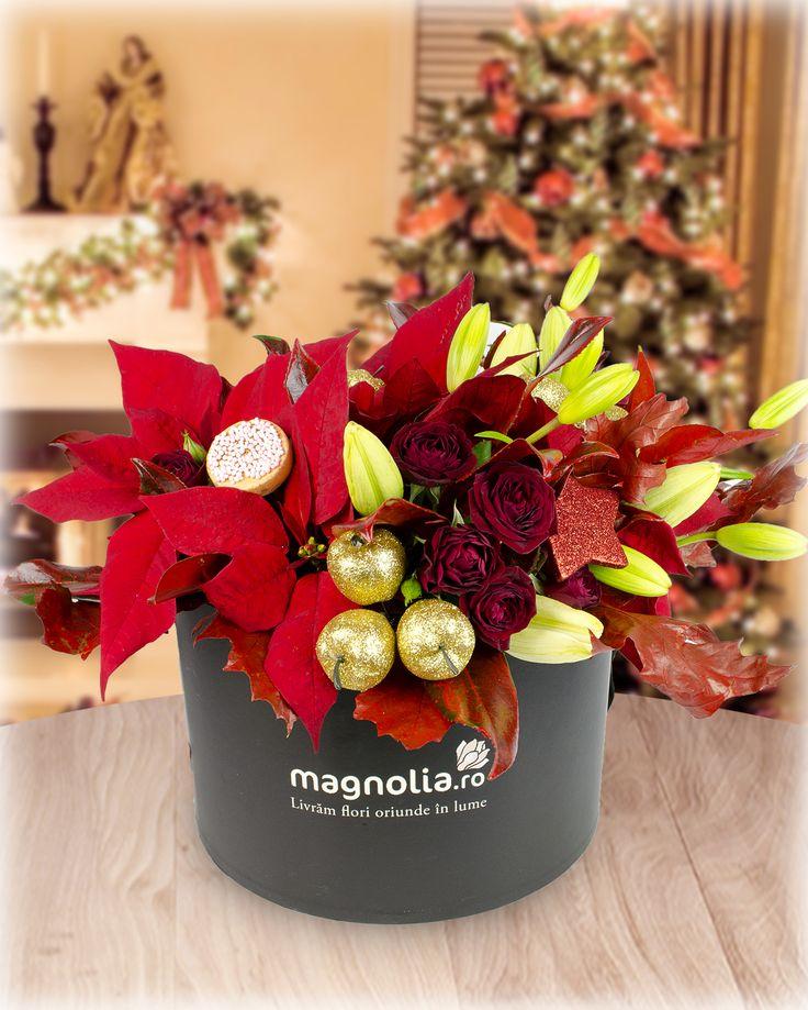 Christmas flower arrangement with Christmas Star, roses, lilies and winter accessories. Aranjament de Craciun cu Craciunite, trandafiri, crini si accesorii de iarna