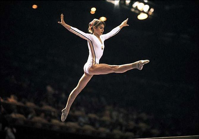 nadia comaneci the first gymnast who Considered the queen of gymnastics, nadia comaneci is an olympic champion and is best-known for scoring the first perfect 100 in olympic competition.