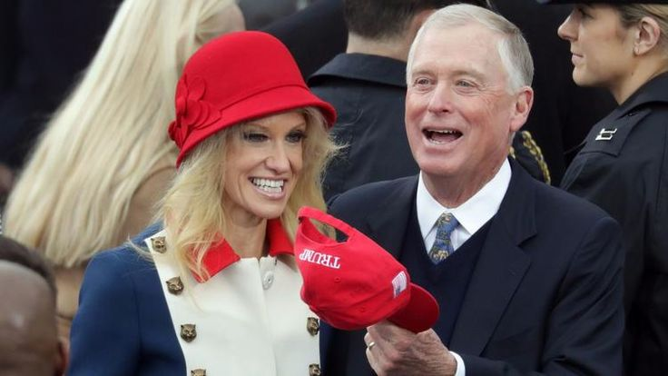 Kellyanne Conway, in Gucci, talks with former Vice President Dan Quayle on Inauguration Day.